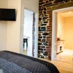 Jimmy Smiths Dairy Fleurieu Peninsula luxury accommodation queen bed and bathroom.